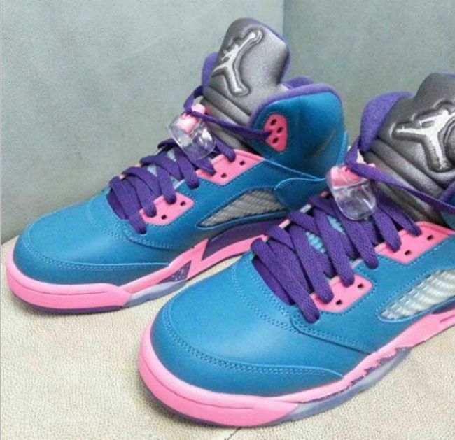 G at a pair of Air Jordan 5 Blue/ Pink/ Purple V GS Sneakers releasing  later this year or early next year.
