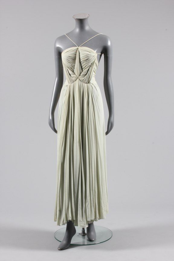 Pale aqua draped jersey evening gown attributed to Alix, circa 1939, the lightly boned bodice pleated with a central point from which others radiate to frame the rib cage, spaghetti straps