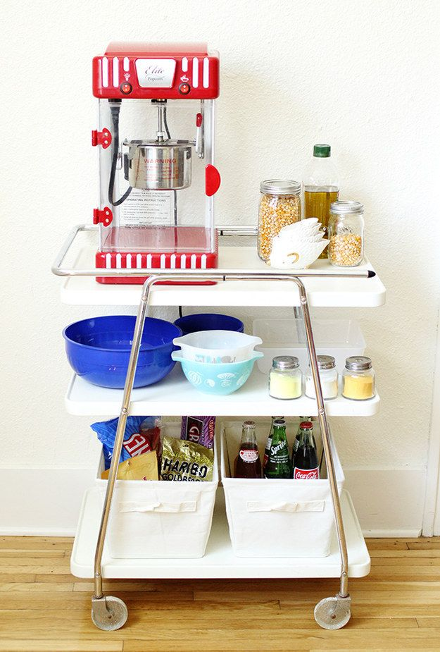 Make one into a movie night popcorn station. | 25 Awesomely Creative Ways To Use A Bar Cart
