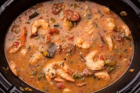Slow cooker shrimp gumbo. You will need fresh shrimp, andouille sausage, canned tomatoes, onion, green bell pepper, celery, and garlic.