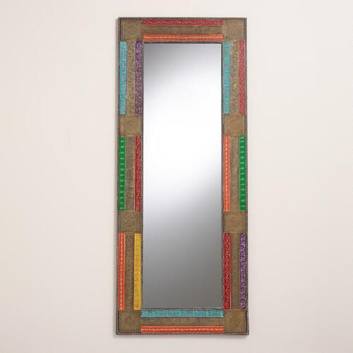 Bright hand-painted panels pop alongside distressed zinc metal panels on our eclectic mirror. Amply proportioned, this handcrafted piece adds light and dimension to any room.
