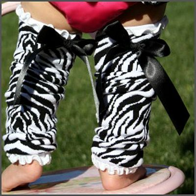Zebra Bow Leg Warmers 'Ella' Collection. Super Adorable! Featuring an attached pink ribbon satin bow, they match perfectly with our ruffled bloomers! A fantastic way to keep your little crawler's knees padded and protected while she's on the move! *** One size fits most *** Recommended fit as a full leg warmer for those under the age of 1, yet super stylish and a perfect fit for your little toddler too.