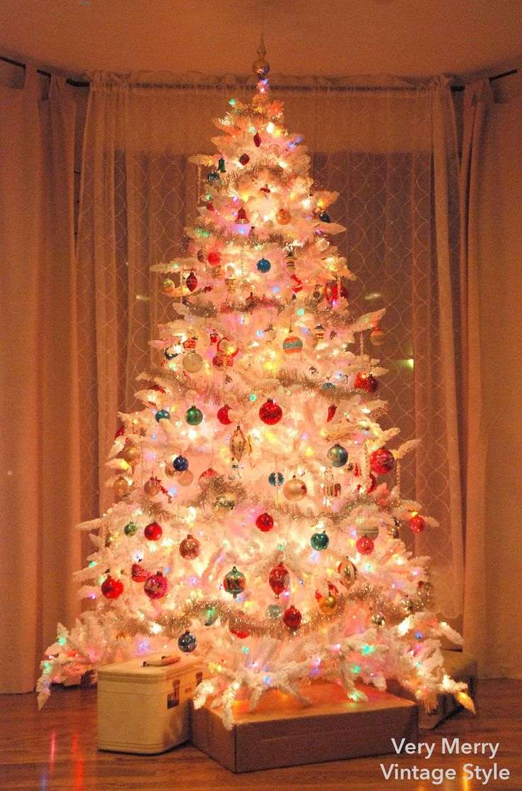 Very Merry Vintage Syle: O {White} Christmas Tree, O {White} Christmas Tree - I loved my white tree...I am going to have to replace it! (Of course I have to have a real tree as well. One for the living room, one for the bedroom. Love going to sleep by the light of a tree.)