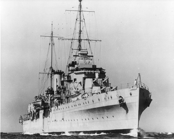 """HMAS Perth circa 1939. Seems to be entering Harbour, with some of the Ship's Company lining the upper Deck in their """"Sixes"""" and the Starboard Whaler extended over the side on her Davit arms. This beautiful Ship was to be sunk along with USS Houston in the Sunda Straits in Indonesia, both ships fighting to the death against a superior Japanese Naval force. Many died on both vessels, with survivors imprisoned and put to work on the infamous """"Burma Railway"""". Not that many survived that!"""