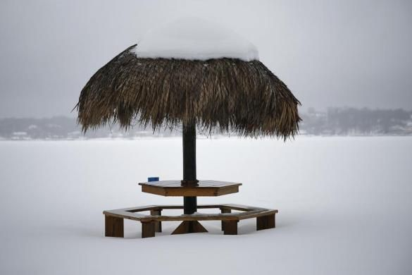 A tiki hut sits buried in snow on Manhasset Bay in Port Washington, New York, February 13, 2014. REUTERS-Shannon Stapleton