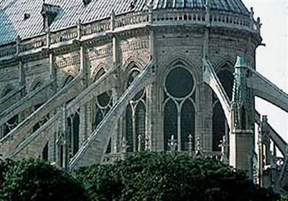 FLYING BUTTRESS - (began primarily in the Gothic period) a freestanding pier of arched masonry that abuts the vertical walls and supports the outward thrust created by higher-walled structures.