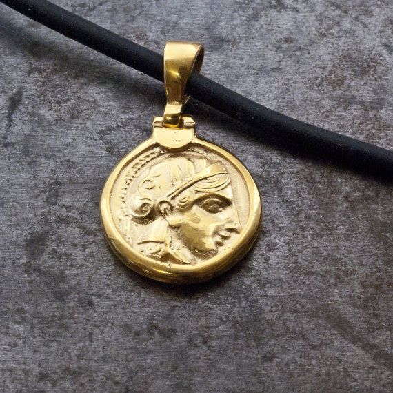 Gold Ancient Greek Coin Necklace, Small Coin Pendant Goddess Athena, Men Pendant, Coin Jewelry, Statement Unisex Necklace, Mens Jewelry  Gold coin pendant with Goddess of wisdom Athena Coin replica of Tetradrachm of Athens (5th century BC) Obverse: a portrait of Athena, patron goddess of the city, in helmet Reverse: the owl of Athens, with an olive sprig and the inscription ΑΘΕ ( of the Athenians )  Sterling silver pendant 24 karat gold plated on gold nylon coated wire or on black silicon…