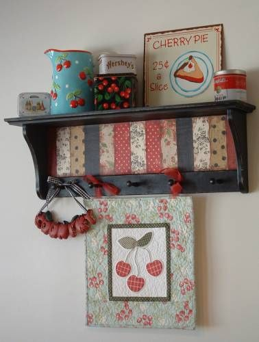 decoupaged shelf and cherry quilt