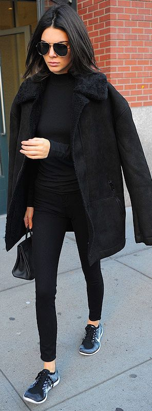 How to wear leggings for winter - Kendall Jenner in a black turtleneck, shearling coat and sneakers