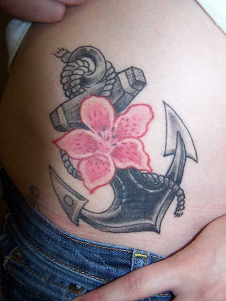 anchor and flower tattoo. I think I'd have it a starfish instead. @Ronda Free Fruehling Beeman Gerk