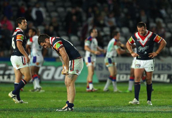 Daniel Conn Photos - Daniel Conn (C) of the Roosters and team mates look dejected after losing the round ten NRL match between the Sydney Roosters and the Newcastle Knights at Bluetongue Stadium on May 15, 2010 in Gosford, Australia. - NRL Rd 10 - Roosters v Knights