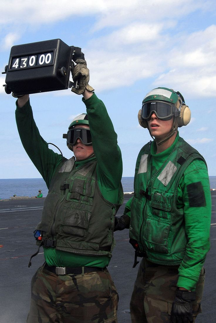 US Navy 080219-N-6326B-025 Aviation Boatswain's Mate (Equipment) Airman Ryan Martin, right, shows Aviation Boatswain's Mate (Equipment) Airman Nicoles Schulmeister how to properly signal with a weight board - Modern United States Navy carrier air operations - Wikipedia, the free encyclopedia