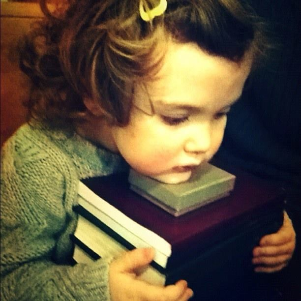 At age 3... going to the library and carrying as many books as your little arms could hold!!