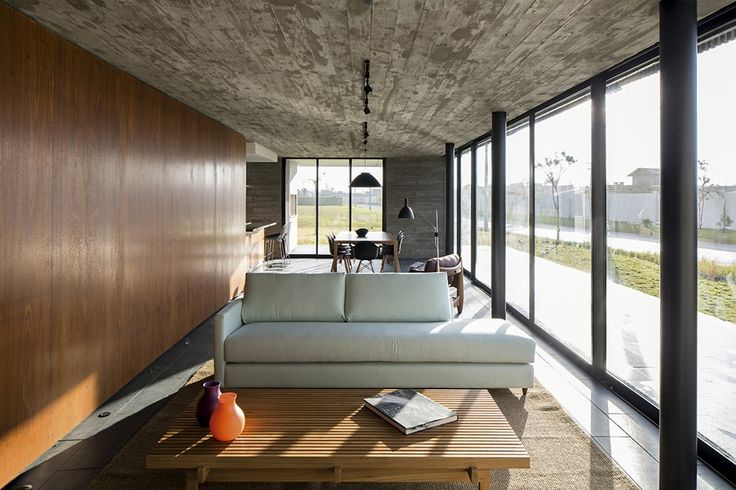 Xan House / MAPA (the raw concrete ceiling, reflected on the back wall creates tension against the wood paneled wall and table, the darkness of the finishes is broken by the glass wall, the tiles mimic the ceilings mold pattern)