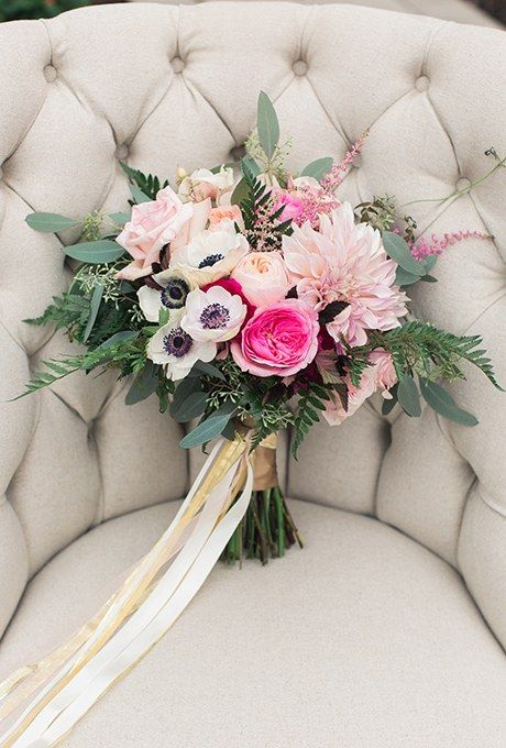 A romantic bouquet comprised of dahlias, garden roses, anemones, astilbe, and eucalyptus, created by Belovely Floral & Event Design.