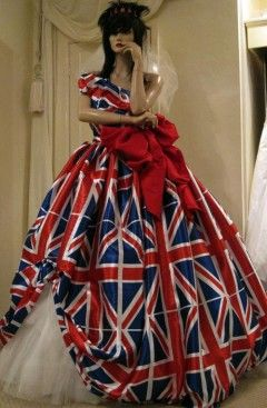 To modernise the theme, the 'Queen' (the mannequin with her mask on) could be dressed in a union jack dress.