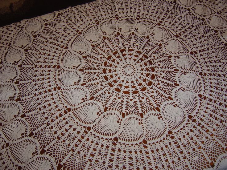 beautiful round hand-crocheted tablecloth