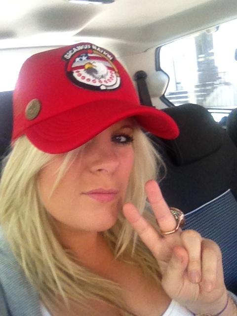 Boydy giving the red Sicangu Nation trucker hat a run.