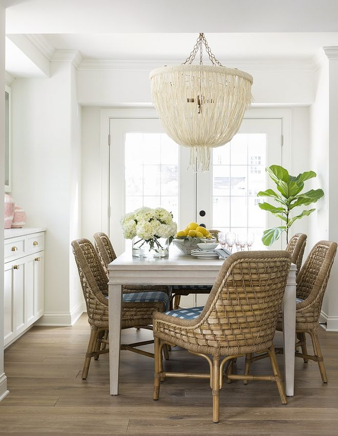 Coastal Relaxed Dining Room With Rattan Dining Chairs Pole Rattan Frame And Legs In Natural Seagrass Tied With Lamp