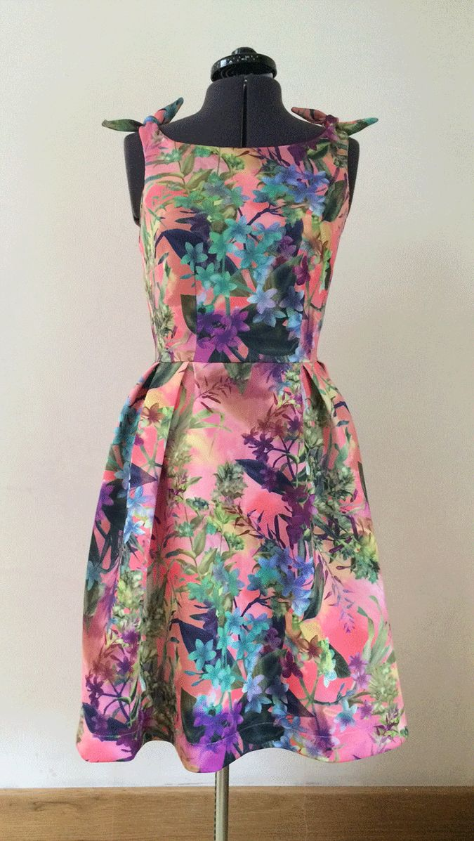 Gorgeous 50's style tea dress with knotted shoulders.