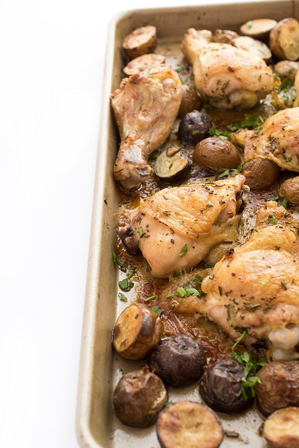 Chicken and potatoes are seasoned with lemon and rosemary then roasted until crispy in this easy and delicious one sheet pan dinner recipe.