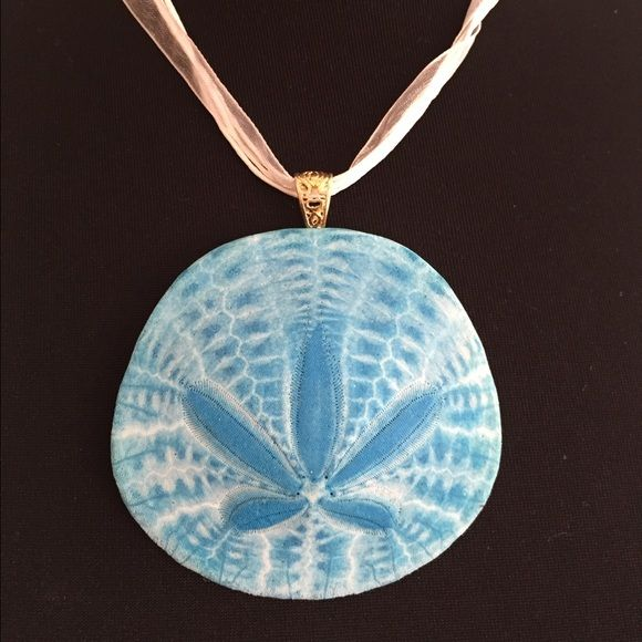 Real sand dollar necklace. Real sand dollar necklace, painted  by me! They are each irregular and unique in shape and color. Range in size from 2-3 inches. Can be used as a necklace or be used as a hanging decoration. Jewelry Necklaces