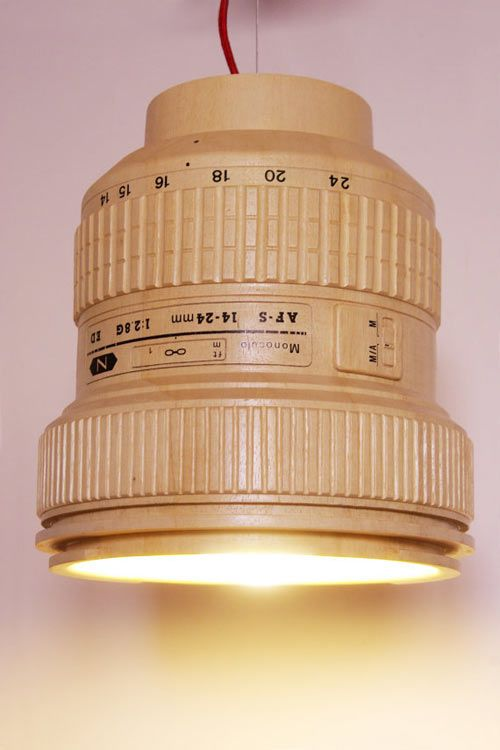 This wooden replica of a reflex camera lens is actually a lamp by Monoculo Design Studio - what a fun idea!