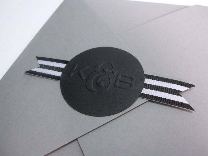 I will DEFINITELY emboss my logo onto stickers.  Awesome! (Also love the black and white striped ribbon)