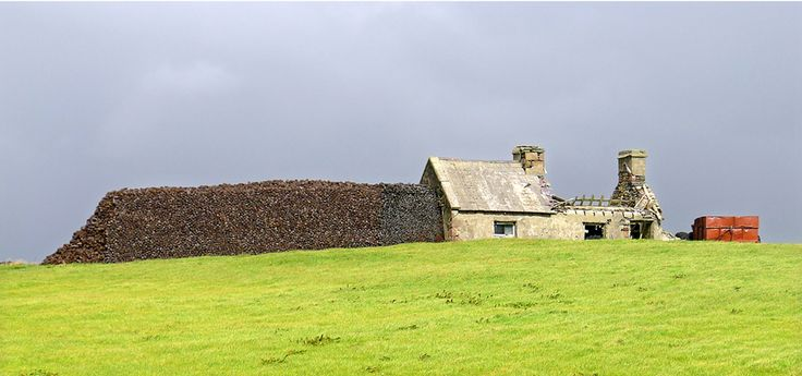 turf agaist a ruin in Ballycroy, county Mayo ©Annie Wright Photography
