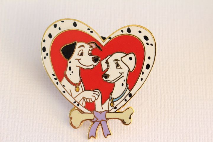 This Disney Pin for sale features the couple Perdita and Pongo from 101 Dalmatians in a heart shape with a bow, a dog bone, and dalmatian spots! Guaranteed Authentic and Scrapper-Free. Earn reward poi