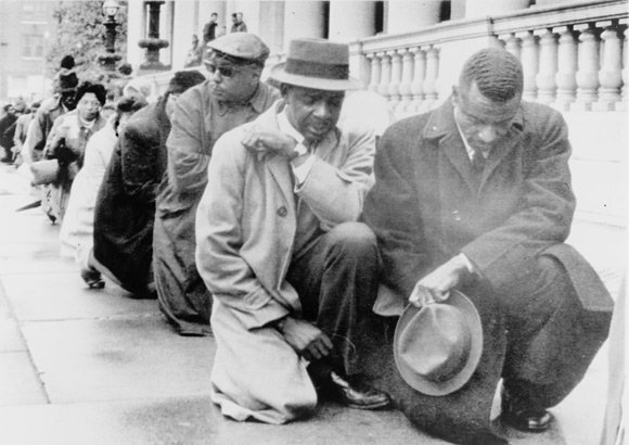 Kneeling on the sidewalk outside City Hall in Birmingham Alabama protesting racial segregation in 1963