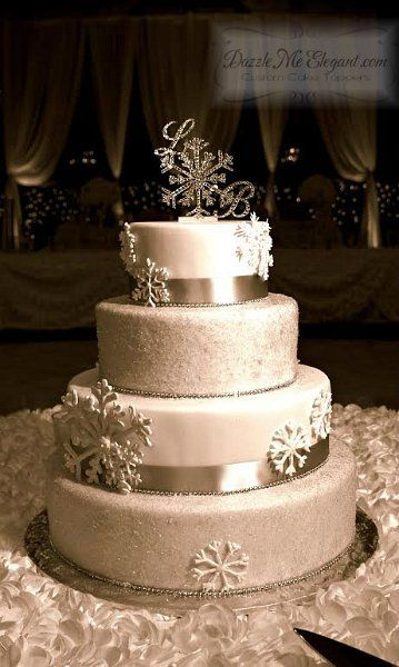 Custom crystal snowflake monogram wedding cake topper -pinned by wedding specialists http://dazzlemeelegant.com