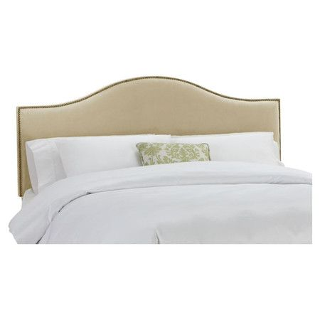 Nailhead-trimmed arch headboard with a pine wood frame and foam cushioning. Handmade in the USA.        Product: Headboard ...