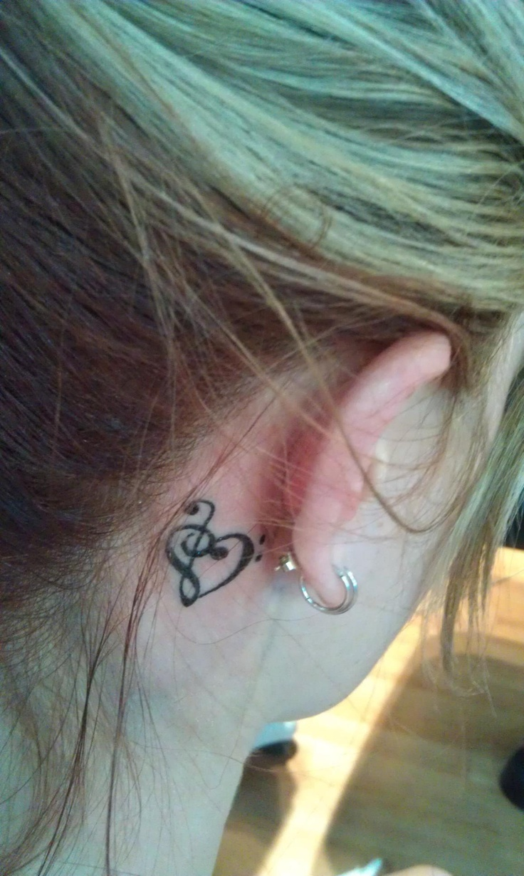 Music heart tattoo - in a tattoo discussion, this is where I would go for sure. But white or brown.