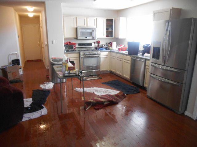 flooded kitchen, wet water damaged wood flooring | wood floor