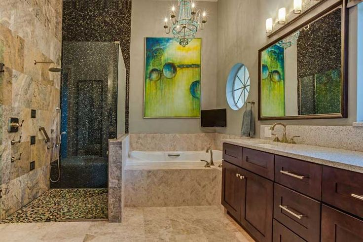 Set among relatively somber colors, the vibrant green wall art gives a refreshing focal point to the bathroom walls. This adds an essence of luxury and vibrancy that defines this classy bathroom.