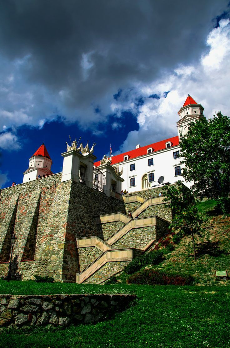 Bratislava Castle. Bratislava Castle is the main castle of Bratislava, the capital of Slovakia. The massive rectangular building with 4 corner towers stands on an isolated rocky hill of the Little Carpathians directly above the Danube river in the middle of Bratislava. The location provides excellent views of Bratislava, Austria and, in clear weather, parts of Hungary. Many legends are connected with the castle.