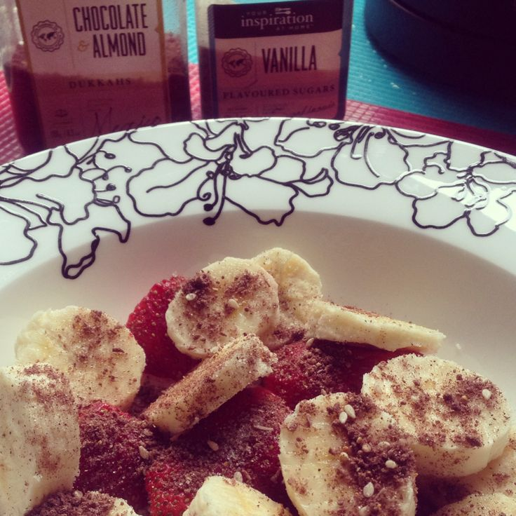 Quick, easy, delicious snack. Strawberries and banana sprinkled with Choc Almond Dukkah