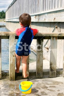 Toddler in Swimsuit by Outdoor Pool Royalty Free Stock Photo