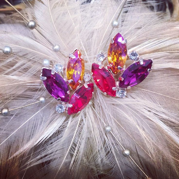 Lovely colours to brighten up winter. Come in store today shop 3087 Westfield Parramatta #ceciles #cecilesjewellery #swarovski #swarovskicrystals #earring #earrings #earringsoftheday #jewelry #jewellery #purple #pink #feathers #love #madewithlove #custommade #orange #wedding #bridal