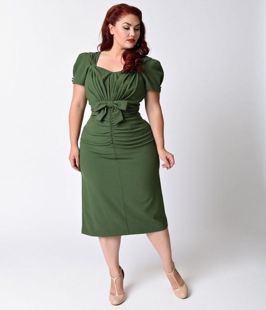 A timeless treasure, dames! A lush olive green plus size dre