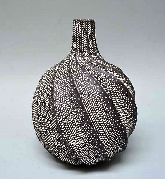 Rare Contemporary Vase by Kitamura Junko | White dots pattern the scalloped swirling form of this vase by Kitamura Junko | The vase is 7-1/2 inches (19 cm) tall, 5-1/2 inches (14 cm) diameter