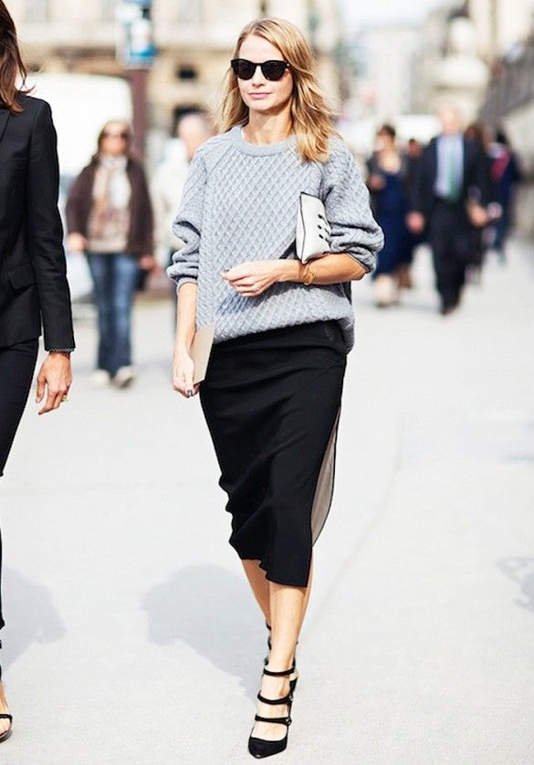 Pair a chunky knit with a sleek black skirt and strappy pumps for a seamless day-to-night look