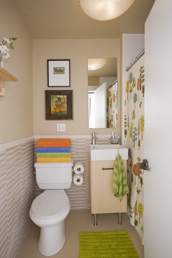 I like the decor...not sure I'd want to keep my clean bath towels stacked on the back of the toilet though
