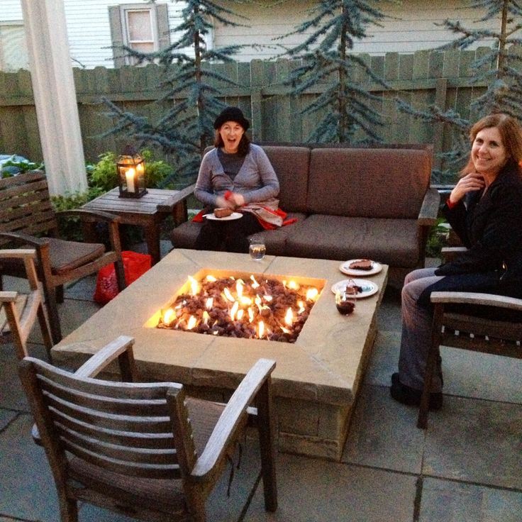 Awesome fire pit in Debbie Jo's garden. Natural gas flames light right up.