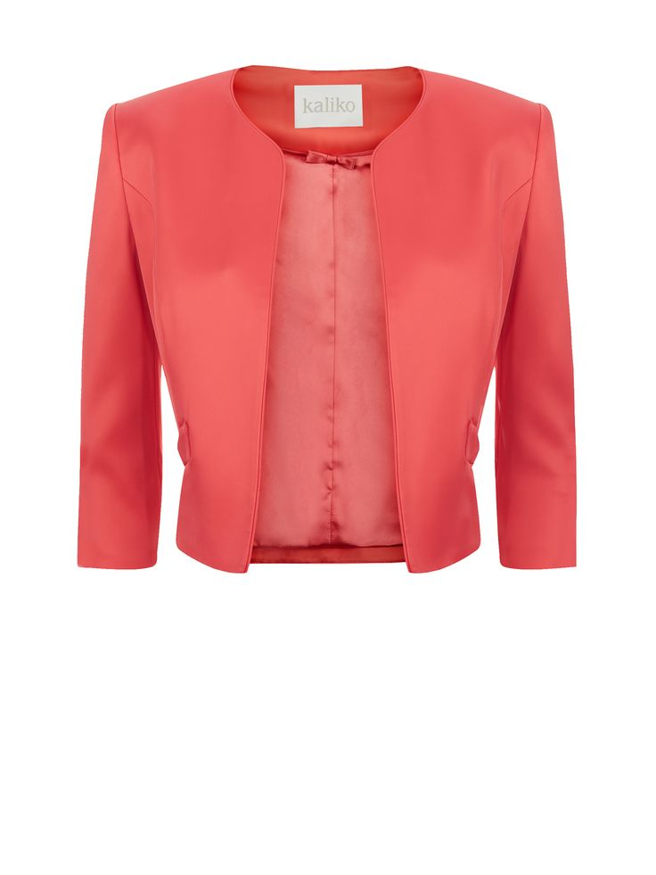 Now reduced to €99!! Satin coral jacket which features piping, with bow detail pockets. Its edge-to-edge style makes it the perfect accompaniment to throw over dresses €169.