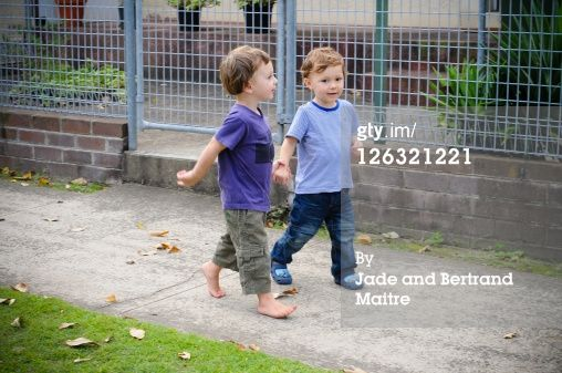 Royalty-free Image: Relaxed friends stroll hand in hand along sidewalk