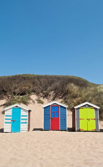 Colourful beach huts on Staunton Sands near Croyde in Devon