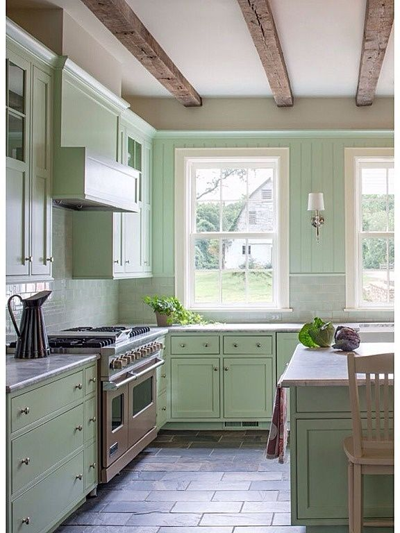 Give your fireplace mantle an accent paint color, as this adds a quick update without having to tear anything out. Benjamin Moore's Color of 2015: Guilford Green   Farmhouse style kitchen, Monochromatic room