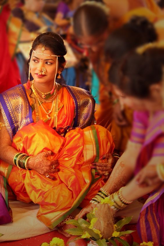 Beautiful Maharashtrian Bride with Orange, Purple, and Green Nauvari Saree